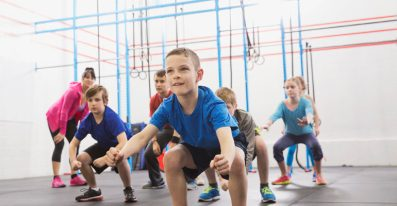 Kids practicing angry gorilla walk in Crossfit class